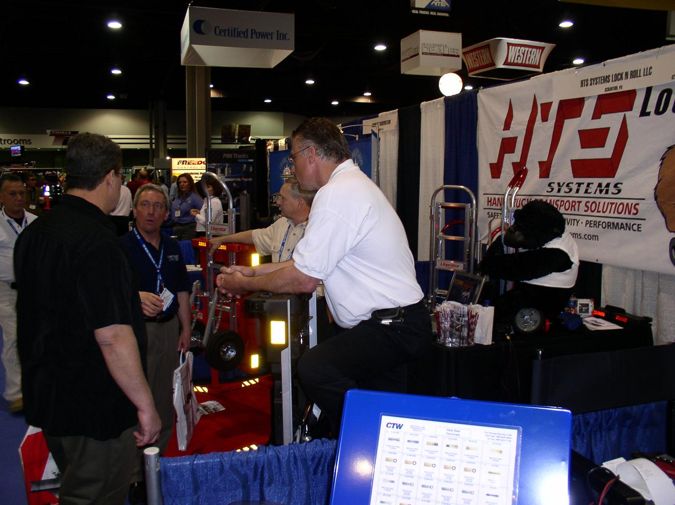 trade show information hts systems lock n roll llc hand truck national truck equipment association ntea mike vacendak and gary o demonstrate the hts ultra rack