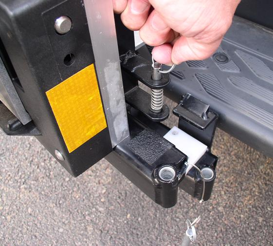 Swing the HTS-20S outward 90 degrees till holding pin latches.